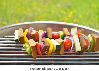 Meatless grilling: Vegetarian skewers with seitan and mixed vegetables on a grill