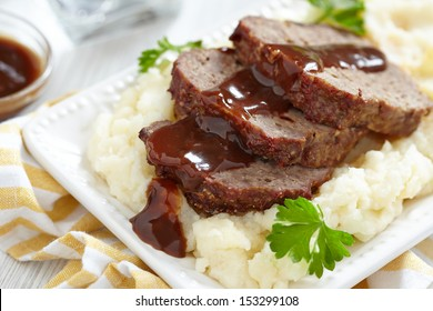 Meatloaf with brown sauce on mashed potato