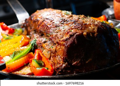 Meatloaf is a dish of ground meat that has been mixed with other ingredients and formed into the shape of a loaf, then baked or smoked.