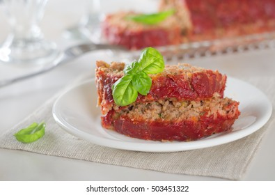Meatloaf with onions, carrots, garlic, bread.