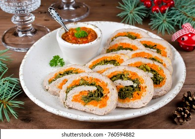 Meatloaf with parsley, cheese and carrots. New year's appetizer