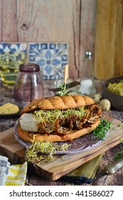meaty sandwich with sprouts