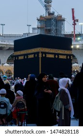 Mecca Holy Mosque, Saudi Arabia - July 2019 : Muslim Girl standing in front of Kaabah with other Muslims praying