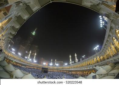 MECCA, S.ARABIA-CIRCA FEB 2012: Fisheye view of Kaabah and Abraj Al Bait (Royal Clock Tower Makkah) in Makkah. The tower is the tallest clock tower in the world at 601m.