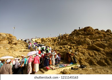MECCA, SAUDI ARABIA - 08/09/2018 : Muslims praying at Mount Arafat (or Jabal Rahmah) during hajj. This is the place where Adam and Eve met after being overthrown from heaven.