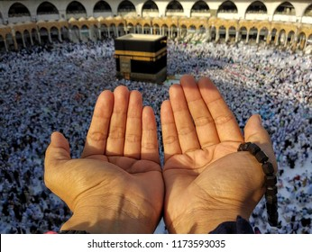 Mecca, Saudi Arabia (08/30/2018) : praying hands of a hajj pilgrim in front of the Kaaba  in Masjidil Haram during hajj session.