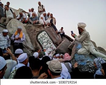 Mecca, Saudi Arabia - 13 August 2017, Pilgrims from around the world gathered to perform Umrah or Hajj. Crowded of Muslim people hiking at Hira cave.