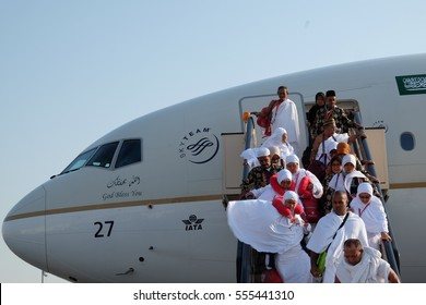 Mecca, Saudi Arabia - 26 Nov. : Muslim pilgrims from Malaysia and Indonesia leaving the airplane in pilgrim dress (ihram) on November 26.