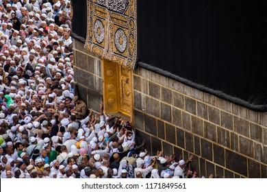MECCA, SAUDI ARABIA - 29 AUGUST 2018: Crowd of people trying to touch the Doors of Holy Kaaba in Masjid Al Haram. Part of Tawaf. They read Dua when touching the doors.