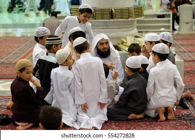 Mecca, Saudi Arabia 30 Nov. 2016 : Muslim children learning Quran or Koran in Prophet's Mosque (Al-Nabawi). The mosque is one of the three holiest mosque in Islam.