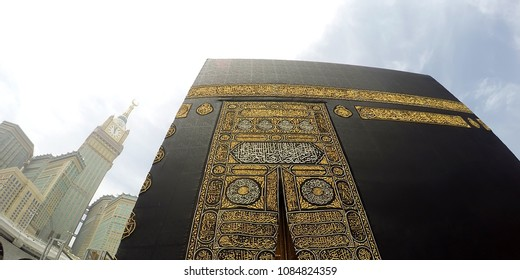 "MECCA, SAUDI ARABIA, April 2017 -Close Up Kaabah Haram Mosque in Mecca.The door of the Kaaba called ""Multazam"".View Makkah Royal Clock Tower (Left)."