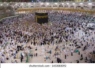 MECCA, SAUDI ARABIA - April 2018 : Muslim pilgrims circumambulate or tawaf the Kaabah after Subuh Prayer at Masjidil Haram, Makkah, Saudi Arabia