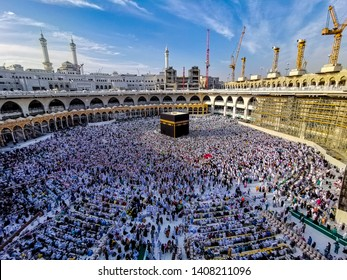 MECCA, SAUDI ARABIA - APRIL 2019 : Muslim pilgrims from all around the World revolving around the Kaaba on April , 2019 in Mecca Saudi Arabia. Muslim people praying together at holy place