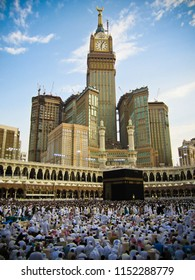 MECCA, SAUDI ARABIA - APRIL 22 2018: View on Holy Kaaba from third floor of Al Haram Mosque. People walk seven times around Kaab making Tawaf, Skyscrapers on background, Abraj Clock Tower
