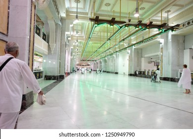 MECCA, SAUDI ARABIA - August 03 2018: Saee Running is a ritual of Hajj and Umra when pilgrim making 7 circles between Safa and Marwa Hills inside Masjid Al Haram. Green light area must be run quickly