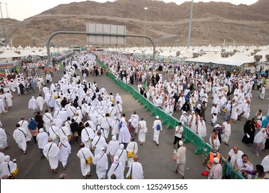 Mecca, Saudi Arabia, August 23, 2018 : Muslim pilgrims walk to perform 'stoning of the devil' ritual at one of wall pillars (jamrah) in Mina Saudi Arabia. it is one of the rituals to complete the hajj
