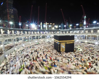 Mecca / Saudi Arabia - December 2 2015 : Motion blur showing movement of pilgrims performing tawaf around Kaabah in the Grand Mosque or Masjidil Haram as part of the requirement for Hajj and Umrah.
