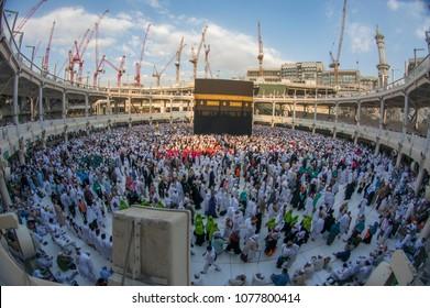 MECCA, SAUDI ARABIA - DECEMBER 22, 2014 : Fish eye view of Muslim pilgrims circumambulate the Kaabah in Makkah, Saudi Arabia.