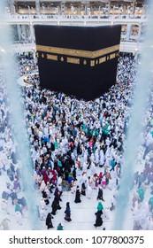 MECCA, SAUDI ARABIA - DECEMBER 23, 2014 : Top view of Muslim pilgrims circumambulate the Kaabah in Makkah, Saudi Arabia.