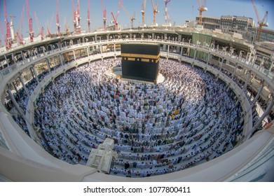 MECCA, SAUDI ARABIA - DECEMBER 24, 2014 : Fish eye view of Muslim pilgrims circumambulate the Kaabah in Makkah, Saudi Arabia.