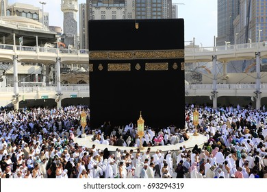 MECCA, SAUDI ARABIA - DECEMBER 4, 2014: Muslim pilgrims from all over the world performing tawaf at holy Kaabah in the morning. Muslims face the direction of Kaaba when performing prayer.