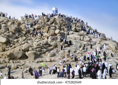 MECCA, SAUDI ARABIA - FEB 3: Muslims at Mount Arafat (or Jabal Rahmah) February 3, 2015 in Arafat, Saudi Arabia. This is the place where Adam and Eve met after being overthrown from heaven.