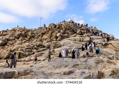 MECCA, SAUDI ARABIA - FEB 8: Muslims at Mount Arafat (or Jabal Rahmah) February 8, 2017 in Arafat, Saudi Arabia. This is the place where Adam and Eve met after being overthrown from heaven.