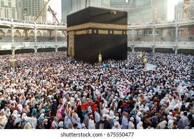 MECCA, SAUDI ARABIA - FEBRUARY 2: Muslim pilgrims from all around the World revolving around the Kaaba on February 2, 2015 in Mecca Saudi Arabia. Muslim people praying together at holy place.
