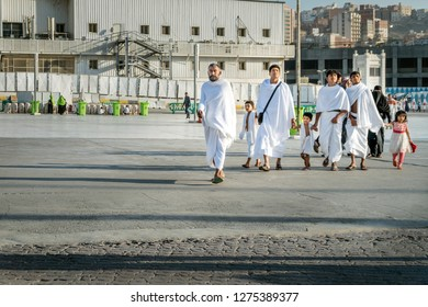 MECCA, SAUDI ARABIA - JAN 28: Muslim wearing ihram clothes and ready for Hajj on January 28, 2017 in Mecca, Saudi Arabia. Muslims all around the world face the Kaaba during prayer time.