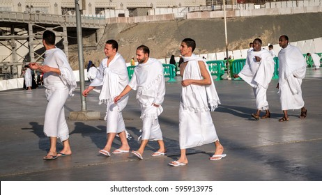 MECCA, SAUDI ARABIA - JAN 30: Muslim wearing ihram clothes and ready for Hajj on January 30, 2017 in Mecca, Saudi Arabia. Muslims all around the world face the Kaaba during prayer time.