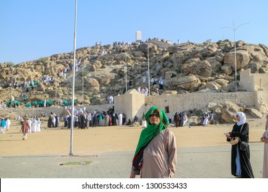 MECCA, SAUDI ARABIA - JANUARY 22, 2014: Muslims at Mount Arafat (or Jabal Rahmah) February 3, 2015 in Arafat, Saudi Arabia. This is the place where Adam and Eve met after being overthrown from heaven.