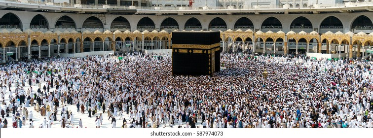 MECCA SAUDI ARABIA - JANUARY 27: Muslim pilgrims from all around the World revolving around the Kaaba on January 27, 2017 in Mecca Saudi Arabia. Muslim people praying together at holy place.