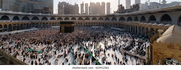 MECCA, SAUDI ARABIA - JANUARY, 30: Muslim pilgrims from all around the World revolving around the Kaaba on January 30, 2017 in Mecca Saudi Arabia. Muslim people praying together at holy place.