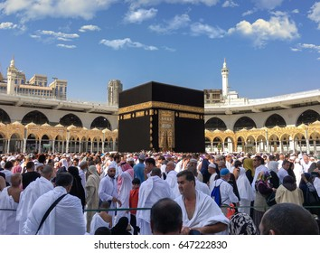 MECCA, SAUDI ARABIA - JANUARY 30: Muslim pilgrims from all around the World revolving around the Kaaba on January 30, 2017 in Mecca Saudi Arabia. Muslim people praying together at holy place.