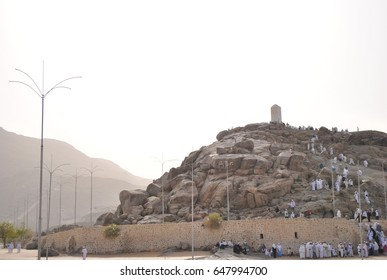 MECCA, SAUDI ARABIA - June 21 2012: Muslims at Mount Arafah (or Jabal Rahmah) This is the place where Adam and Eve met after being overthrown from heaven.