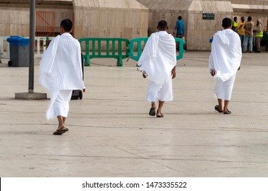 MECCA, SAUDI ARABIA - JUNE 30: Muslim wearing ihram clothes and ready for Hajj on June 30, 2019 in Mecca, Saudi Arabia. Muslims all around the world face the Kaaba during prayer time.