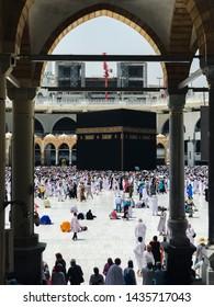 MECCA, SAUDI ARABIA- JUNE 4, 2019:Muslim pilgrims circumambulate the Kaaba from ground floor of Haram Mosque. Muslims all around the world face the Kaaba during prayer time.