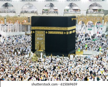 MECCA, SAUDI ARABIA, March 18 2017 - Muslim pilgrims from all over the world gathered to perform Umrah at the Haram Mosque in Mecca. A crowd of pilgrims circumabulate (tawaf) Kaaba with noise effect