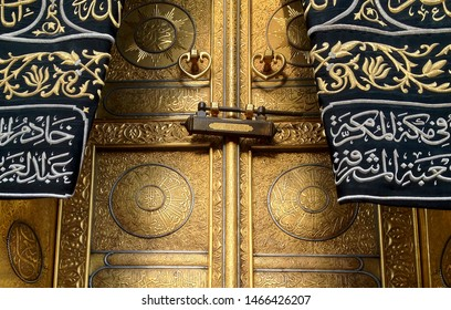 MECCA, SAUDI ARABIA - MARCH 29, 2019 The door of the Kaaba called Multazam at Grant holy mosque Al-Haram in Mecca Saudi Arabia. Muslim Pilgrims at The Kaaba in The Great Mosque of Mecca.