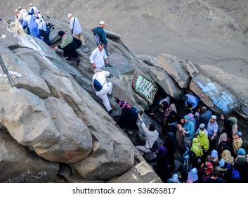 "MECCA, SAUDI ARABIA - MARCH 30,2016: Muslim pilgrims visit the Hira' cave located at the peak of Mount of Light ""Jabal An-Nour"" whereby Prophet Muhammad received his first revelations from Allah"