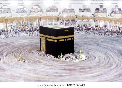 MECCA, SAUDI ARABIA - MAY 01 2018: Crowd of people making Tawaf around The Holy Kaaba in Makkah during Umra or Hajj, View from the top of Masjid Al Haram. Long Exposure at night