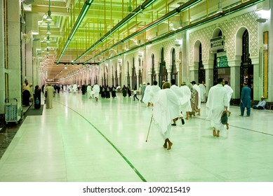 MECCA, SAUDI ARABIA - MAY 02 2018: Saee Running is a ritual of Hajj and Umra when pilgrim making 7 circles between Safa and Marwa Hills inside Masjid Al Haram. Green light area must be run quickly