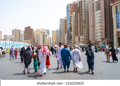 MECCA, SAUDI ARABIA - MAY 03 2018: Real life in Mecca right behind Abraj Clock Tower. Crowd of pilgrims and local people walking to and from Masjid Al Haram. Cheap hotel in background