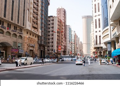 MECCA, SAUDI ARABIA - MAY 03 2018: Main roads of Mecca not often free of cars, but always surrounded of hotels, cheap buildings with poor architecture. Streets have no infrastructure for people