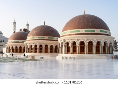MECCA, SAUDI ARABIA - MAY 07 2018: Three 3 domes on the roof top of the Grand Mosque of Mecca or Masjid Al Haram, the holiest mosque for muslims, where Holy Kaaba is located. Roof is open for people