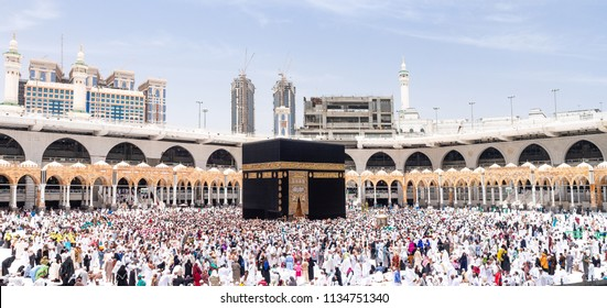 MECCA, SAUDI ARABIA - MAY 07 2018: Amazing wide panorama of Holy Kaaba inside Masjid Al Haram or Grand Mosque of Mecca. People walking around 7 circles making Tawaf, a part of Hajj and Umrah