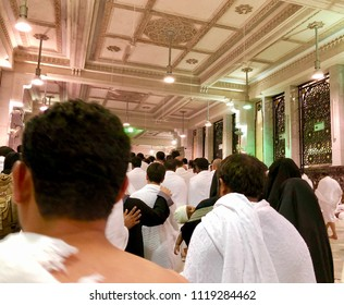 MECCA, SAUDI ARABIA - MAY 15, 2018:Closeup of  Muslim pilgrims perform saei (brisk walking) from Safa mount from Marwah mount. Selective focus and crop fragment.