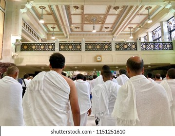 MECCA, SAUDI ARABIA - MAY 15, 2017: Closeup of  Muslim pilgrims perform saei (brisk walking) from Safa mount from Marwah mount with selective focus and crop fragment