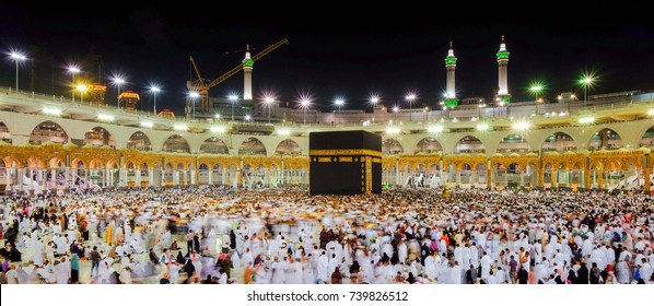 MECCA, SAUDI ARABIA  - MAY12 2017 : Muslim pilgrims from all around the World revolving around the Kaaba in Mecca Saudi Arabia. Muslim people praying together at holy place.