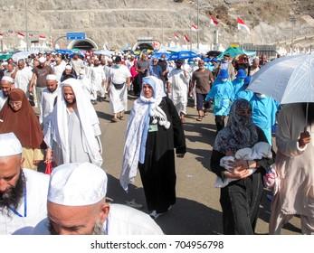 Mecca, Saudi Arabia. - November 27, 2009 ; Pilgrims walking to Jamarah to perform symbolic stoning of the devil by throwing seven stones at the three pillars.